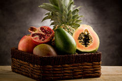 Basket with tropical fruits Stock Photos
