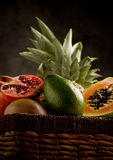 Basket with tropical fruits Royalty Free Stock Photos