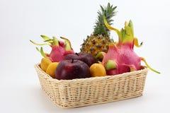 A basket of tropical fruits Stock Photos