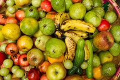 Basket with tropical fruits and vegetables. Set of tropical fruits. Fruits for the holiday table. The rich harvest of fruits. Various fruits. Different tastes Royalty Free Stock Image