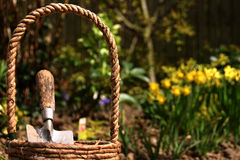 Basket and trowel. Close-up of a gardening basket containing a trowel Stock Photo