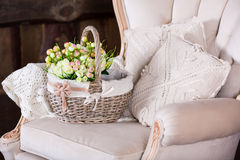 Basket with tulips on vintage chair Royalty Free Stock Images