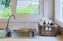 Basket of utensil with sink Stock Photography
