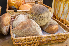 Basket with various bread types Stock Image