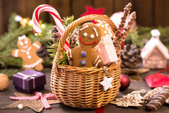 Basket of various Christmas treats, gingerbread man on the table Royalty Free Stock Photo