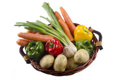 Basket with vegetable on bright background Stock Photo