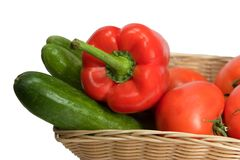 Basket with vegetables. On white background with clipping path Stock Image