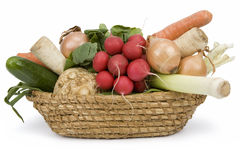 Basket of vegetables. Heap of vegetables in basket isolated on white. Clipping path incl Royalty Free Stock Photos