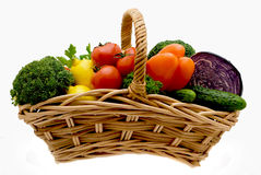 Basket with vegetables. Juicy lemons, tomatoes, pepper, a broccoli, an onions and cabbage Stock Images