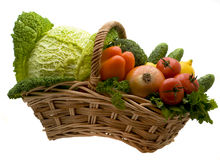 Basket with vegetables. Juicy lemons, tomatoes, pepper, broccoli, onions, cabbage Royalty Free Stock Photo