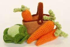 Basket with Vegetables: cabbage and carrots Royalty Free Stock Images