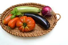 Basket with vegetables in front on white background Royalty Free Stock Images