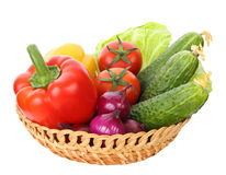 Basket with vegetables isolated on white background Stock Image
