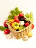 Basket with vegetables. Basket with vegetables and mushrooms Royalty Free Stock Photo