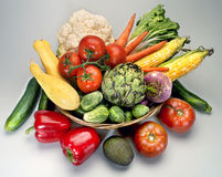 Basket vegetables. Tomatoes peppers squash, avacado Stock Photo