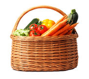 Basket with vegetables on white background Stock Images