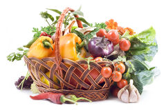 Basket with vegetables on white background. Royalty Free Stock Photo