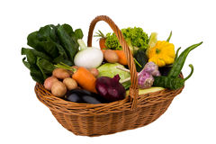 Basket with vegetables on a white background Stock Photography