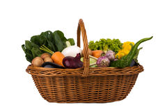 Basket with vegetables on a white background. Basket with vegetables Isolated on a white background Royalty Free Stock Photos