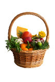 Basket with vegetables on a white background. Wicker Basket with vegetables on a white background Stock Photography