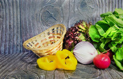 Basket with vegetables. On wood stock photos
