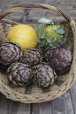 A basket of vegetables. On a wooden plank Royalty Free Stock Photography