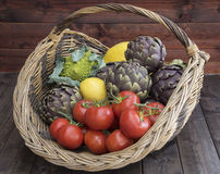 A basket of vegetables. On a wooden plank Royalty Free Stock Image