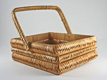 Basket w/Handle. An empty wood and woven basket with a handle opens a field of possible objects with which to fill Royalty Free Stock Photos