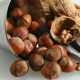 Basket of walnuts and hazelnuts Royalty Free Stock Images