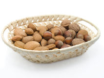 Basket with walnuts, hazelnuts, Almonds Royalty Free Stock Images