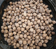 Basket of walnuts on the market square Royalty Free Stock Images