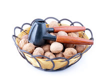 A basket of walnuts and walnut open tools. On white background Royalty Free Stock Images