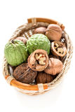 Basket with walnuts. Stock Photo