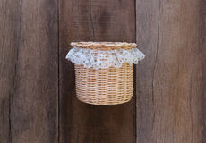 Basket weave of handicraft on old wooden. Royalty Free Stock Photography