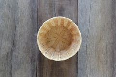 Basket weave of handicraft on old wooden. Royalty Free Stock Photos