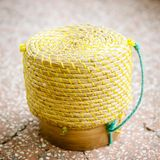 Basket weave pattern with palm leaves for the sticky rice steame. A basket weave pattern with palm leaves for the sticky rice steamed inside Royalty Free Stock Photography