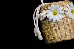 Basket weave with white flower and white rope on black background.  Royalty Free Stock Photography