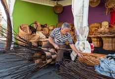 A basket weaver at work in the factory shop in Camacha Stock Photos