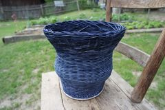 Basket weaving, basketry, blue basket making, hobby royalty free stock photography