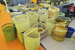 Basketry. Basket weaving is the process of weaving or sewing pliable materials into two- or three dimensional artifacts, such as mats or containers. Craftspeople stock images