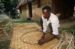 Basket weaving in Uganda. Basket weaving by a male adult in Uganda Royalty Free Stock Photography