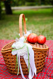 Basket with white ornaments and apples Stock Image