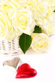 Basket of white roses with two hearts Royalty Free Stock Photo
