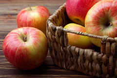 Basket of wicker apples Royalty Free Stock Photos