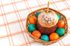 Easter eggs and and cake in basket isolated Royalty Free Stock Photos