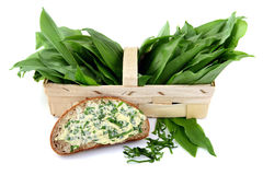 Basket of wild garlic. slice of bread with garlic butter. White isolated background Stock Image