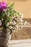 Basket of wildflowers on a bicycle, vertical photography royalty free stock image