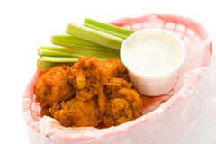 Basket of Wings. Basket of spicy buffalo chicken wings isolated on white Royalty Free Stock Photos