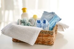 Free Basket With Baby Clothes, Cosmetics And Toy On Table Royalty Free Stock Images - 151300179