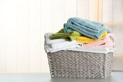 Free Basket With Clean Laundry On Table At Home Royalty Free Stock Photos - 149725198